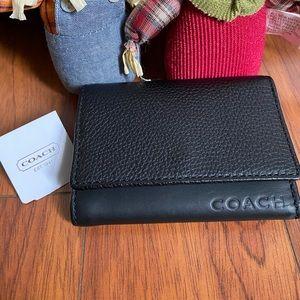 Coach keychains & Wallet